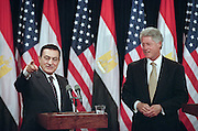 Egyptian President Hosni Mubarak answers a question with U.S. President Bill Clinton during a joint press conference at the White House, July 1, 1999. The two leaders met privately behind closed doors looking for a lasting peace solution in the Middle East.
