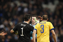 (l-r) goalkeeper Gianluigi Buffon of Juventus FC, referee Michael Oliver, Giorgio Chiellini of Juventus FC during the UEFA Champions League quarter final match between Real Madrid and Juventus FC at the Santiago Bernabeu stadium on April 11, 2018 in Madrid, Spain
