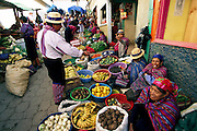Especially busy during the days before the All Saints Day holidays, the village market of Todos Santos Cuchumatán spills out of the big, concrete municipal market and extends down side streets. Hungry Planet: What the World Eats (p. 160). This image is featured alongside the Mendoza family images in Hungry Planet: What the World Eats.
