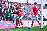 Cauley Woodrow of Barnsley (9) scores a goal and celebrates with Jacob Brown of Barnsley (33) to make the score 2-0 during the EFL Sky Bet League 1 match between Barnsley and Wycombe Wanderers at Oakwell, Barnsley, England on 16 February 2019.