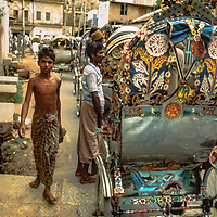 Pedicab peddlers wait for a fare on the streets of  Dhaka, Bangladesh in 1977.