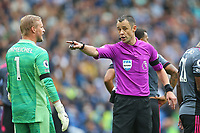 Football - 2021 / 2022 Premier League - Brighton & Hove Albion vs Leicester City - Amex Stadium - Sunday 19th September 2021<br /> <br /> Referee Mr Stuart Attwell tells Kasper Schmeichel of Leicester City to return to his goal to face the penalty kick during the Premier League match at The Amex Stadium Brighton  <br /> <br /> COLORSPORT/Shaun Boggust