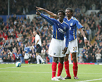 Photo: Lee Earle.<br /> Portsmouth v Bolton Wanderers. The FA Barclays Premiership. 18/08/2007.Portsmouth's Benjani (L) celebrates with Kanu after he scored their first goal.