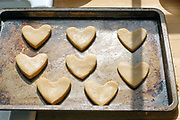A baking tray of heart shaped gingergread biscuits on 30th March 2020 in North Yorkshire, United Kingdom.