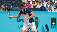 Tennis - 2019 Queen's Club Fever-Tree Championships - Day Six, Saturday<br /> <br /> Men's Singles, Semi Final: Daniil Medvedev (RUS) Vs. Gilles Simon (FRA) <br /> <br /> Daniil Medvedev (RUS) opens his frame as be prepares to return the serve on Centre Court.<br />  <br /> COLORSPORT/DANIEL BEARHAM