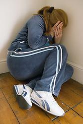 Woman cowering in the corner,