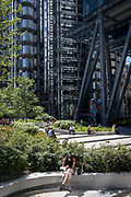 Office workers enjoy a sunlit lunch-hour at Leadenhall in the City of London, the capital's financial district, on 8th June 2021, in London, England.