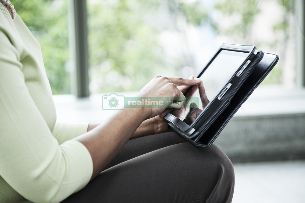 June 17, 2010 - A closeup of the hands of a black businesswoman working on a ntoebook computer. (Credit Image: © Mint Images via ZUMA Wire)