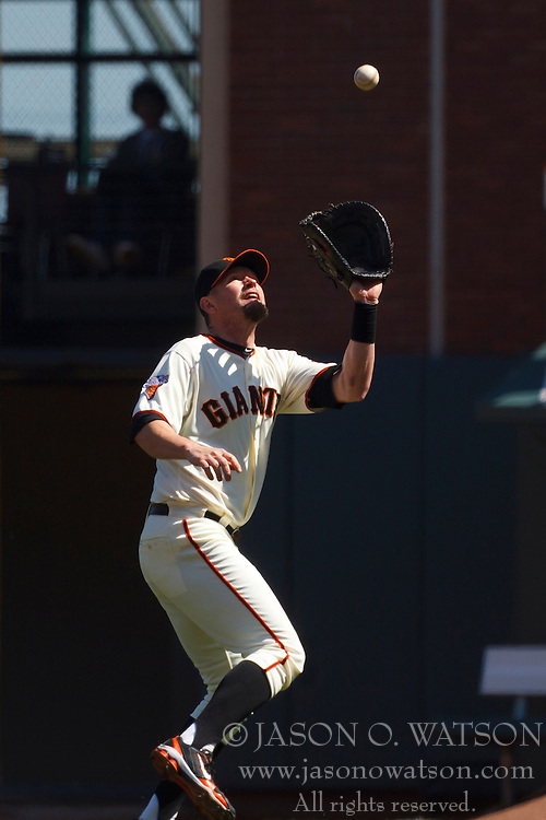 September 4, 2011; San Francisco, CA, USA;  San Francisco Giants first baseman Aubrey Huff (17) catches a fly ball against the Arizona Diamondbacks during the seventh inning at AT&T Park.