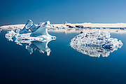 Two icebergs bisect the D'Urville Monument on a clear blue day, Antarctic Sound, Antarctica