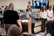 MMSD board member Ali Muldrow, center, smiles during the Madison Metropolitan School Board swearing-in ceremony at Cesar Chávez Elementary School in Madison, WI on Monday, April 29, 2019.