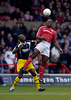 Photo: Jed Wee.<br />Nottingham Forest v Weymouth. The FA Cup.<br />05/11/2005.<br />Forest's Wes Morgan (R) jumps to deny Weymouth's Chukki Eribenne.