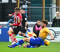 Lincoln City's Shay McCartan vies for possession with  Mansfield Town's Ryan Sweeney<br /> <br /> Photographer Andrew Vaughan/CameraSport<br /> <br /> The EFL Sky Bet League Two - Lincoln City v Mansfield Town - Saturday 24th November 2018 - Sincil Bank - Lincoln<br /> <br /> World Copyright © 2018 CameraSport. All rights reserved. 43 Linden Ave. Countesthorpe. Leicester. England. LE8 5PG - Tel: +44 (0) 116 277 4147 - admin@camerasport.com - www.camerasport.com