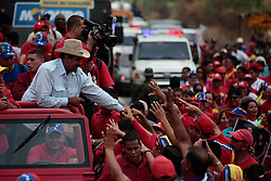 Photo provided by Command Campaign Hugo Chavez shows Venezuela's Acting President and presidential candidate Nicolas Maduro clapping with supporters as President of Venezuelan Parliament Disodado Cabello drives the vehicle before a rally in Barinas, Venezuela, April 2, 2013. The electoral campaign in Venezuela, heading for the upcoming presidential elections on April 14, officially started on Tuesday and will run for 10 days, during which the candidates will present their proposals to the entire country. , April 2, 2013.. Photo by Imago / i-Images...UK ONLY..