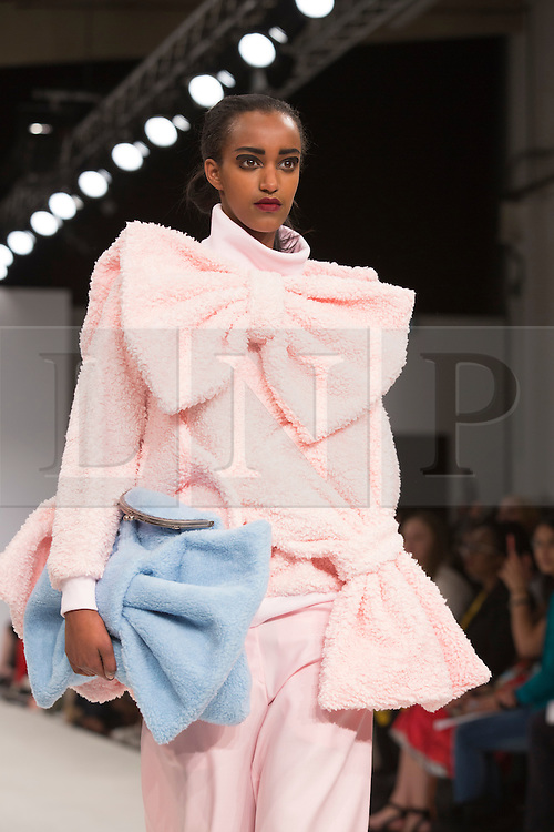 © Licensed to London News Pictures. 30/05/2015. London, UK. A model walks the runway during the Birmingham City University fashion show at Graduate Fashion Week 2015 wearing the collection of graduate student Anna Cammish. Graduate Fashion Week takes place from 30 May to 2 June 2015 at the Old Truman Brewery, Brick Lane. Photo credit : Bettina Strenske/LNP