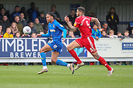 AFC Wimbledon defender Toby Sibbick (20) battles for possession with Accrington Stanley defender Ben Richards-Everton (5) during the EFL Sky Bet League 1 match between AFC Wimbledon and Accrington Stanley at the Cherry Red Records Stadium, Kingston, England on 6 April 2019.