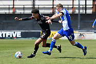 Morgan Rogers (27) of Lincoln City battles for possession with Alfie Kilgour (15) of Bristol Rovers during the EFL Sky Bet League 1 match between Bristol Rovers and Lincoln City at the Memorial Stadium, Bristol, England on 17 April 2021.