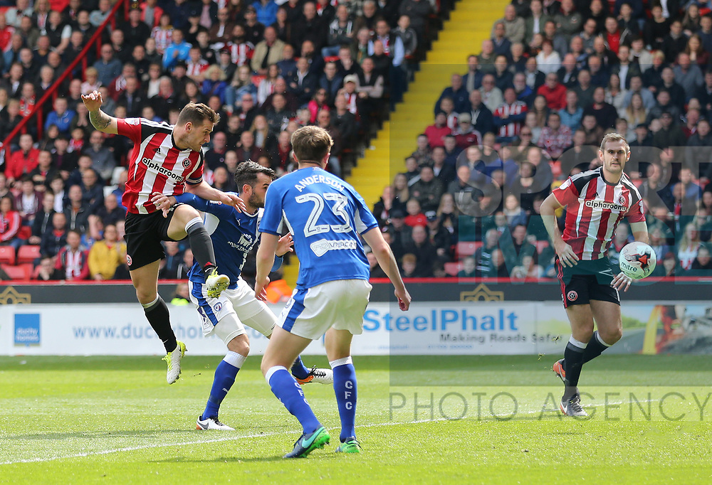Sheffield United's Billy Sharp scoring his sides second goal during the League One match at Bramall Lane, Sheffield. Picture date: April 30th, 2017. Pic David Klein/Sportimage