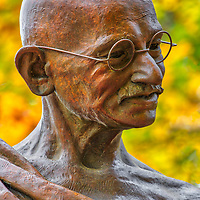 New England fall foliage peak colors framing the bronze statue of Mahatma Gandhi at the Pacifist Memorial of The Peace Abbey in Sherborn, Massachusetts.<br /> <br /> Massachusetts fall foliage and Mahatma Gandhi photos are available as museum quality photo, canvas, acrylic, wood or metal prints. Wall art prints may be framed and matted to the individual liking and interior design decoration needs:<br /> <br /> https://juergen-roth.pixels.com/featured/mahatma-gandhi-juergen-roth.html<br /> <br /> Good light and happy photo making!<br /> <br /> My best,<br /> <br /> Juergen