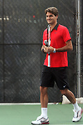 Roger Federer at the Nike Youth Tennis  Challenge held at The Nike -Built regulation Tennis Court  on West 23rd Street & Broadway in New York  City . ..Hundreds of tennis fans and youth form New York  Parks and Rec. Athlethes for Charity, and Mentoring USA are treating to tips and guidance from Tennis Pros Roger Federer, Rafael Nadal and Serena Williams...