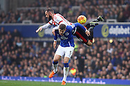 John Stones of Everton and Steven Fletcher of Sunderland collide as they jump for the ball. Barclays Premier League match, Everton v Sunderland at Goodison Park in Liverpool on Sunday 1st November 2015.<br /> pic by Chris Stading, Andrew Orchard sports photography.