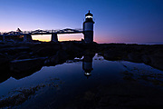 Dawn breaks over the Marshall Point Lighthouse, reflected in a tidal pool near Port Clyde, Maine. The current lighthouse was built in 1832 on a rocky point of land near the mouth of Port Clyde Harbor and was featured in the major motion picture Forrest Gump.