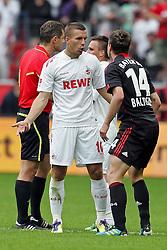 17.09.2011,  BayArena, Leverkusen, GER, 1.FBL, Bayer 04 Leverkusen vs 1. FC Koeln, im Bild.Lukas Podolski (Koeln #10) (L) und Hanno Balitsch (Leverkusen #14) geraten aneinander..// during the 1.FBL, Bayer Leverkusen vs 1. FC Köln on 2011/09/17, BayArena, Leverkusen, Germany. EXPA Pictures © 2011, PhotoCredit: EXPA/ nph/  Mueller *** Local Caption ***       ****** out of GER / CRO  / BEL ******