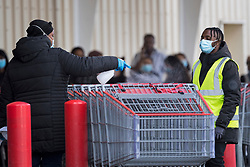 © Licensed to London News Pictures. 25/09/2020. London, UK. Shop staff disinfect shopping trolleys at COSTCO in Hayes west London, as signs of panic buying emerge following the threat of further lockdown measures across the capital. Photo credit: Ben Cawthra/LNP