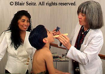 Doctor, Physician at Work, Caucasian Doctor, Hispanic Boy Patient, Hispanic Mother, Pediatrics