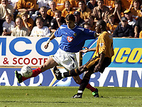 Copyright Sportsbeat Images. 01494 783165<br />Picture: Henry Browne<br />Date: 30/08/2003<br />Woverhampton Wanderers v Portsmouth FA Barclaycard Premiership<br />Boris Zivkovic of Portsmouth blocks a pass from Shaun Newton of Wolves