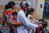 A family of four ride a motorcycle in Srinagar, Kashmir, Jammu and Kashmir State, India.