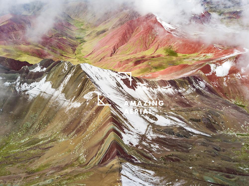 Aerial view of snowy peaks of Vinicunca, Rainbow Mountain, Peru.