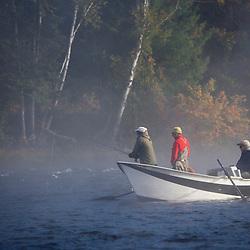 Fly-fishing from a driftboat near Moosehead Lake Maine USA
