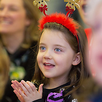 Lucy Golmen from Galway watching the puppet show before boarding her Santa flight