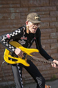 Old man plays guitar and entertains passing crowd. Grand Old Day Festival. St Paul Minnesota MN USA