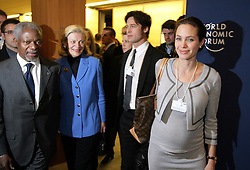 Pregnant Angelina Jolie, UNHCR Goodwill Ambassador and her boyfriend Brad Pitt with U.N General secretary Kofi Annan and his wife Nane leave the session 'A New Mindset for the UN' at the Annual Meeting 2006 of the World Economic Forum in Davos, Switzerland, on January 26, 2006. Pool photo by Peter Klaunzer/World Economic Forum/ABACAPRESS.COM