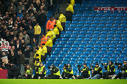MANCHESTER, ENGLAND - Sunday, February 13, 2010: Photographer's sitting in front of empty seats as Manchester City take on Stoke City during the FA Cup 5th Round match at the City of Manchester Stadium. (Photo by David Rawcliffe/Propaganda)  MANCHESTER, ENGLAND - Sunday, February 13, 2010: Manchester City xxxx and Stoke City's xxxx during the FA Cup 5th Round match at the City of Manchester Stadium. (Photo by David Rawcliffe/Propaganda)