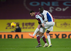 Dwight McNeil of Burnley (L) and Cheikhou Kouyate of Crystal Palace in action - Mandatory by-line: Jack Phillips/JMP - 23/11/2020 - FOOTBALL - Turf Moor - Burnley, England - Burnley v Crystal Palace - English Premier League