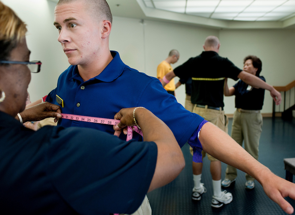 """A freshman is measured for Naval uniforms during his processing on his first day at the U.S. Naval Academy in Annapolis, MD. Approximately 1,230 young men and women arrived at the U.S. Naval Academy's Alumni Hall, Thursday, July 1, for Induction Day to begin their new lives as """"plebes"""" or midshipmen fourth class (freshmen). """"I-Day"""" culminates when the members of the Class of 2014 take the oath of office at a ceremony at 6 p.m. in Tecumseh Court, the historic courtyard of the Bancroft Hall dormitory. Over 17,400 young men and women applied to be members of the Naval Academy Class of 2014 - a record for USNA."""