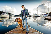 Writer Bob Friel with his dog Murphy, at the Deer Harbor Marina, near his home in Deer Harbor, Orcas Island, WA. Colton Harris-Moore had once broken in to the Marina office & store although he did not steal any boats from this marina.