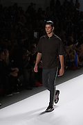 A men's outfit with black, gray and tan trousers and black top by Richard Chai at the Spring 2013 Mercedes Benz Fashion Week show in New York.