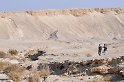 Israel, Arava two hikers in a desert landscape