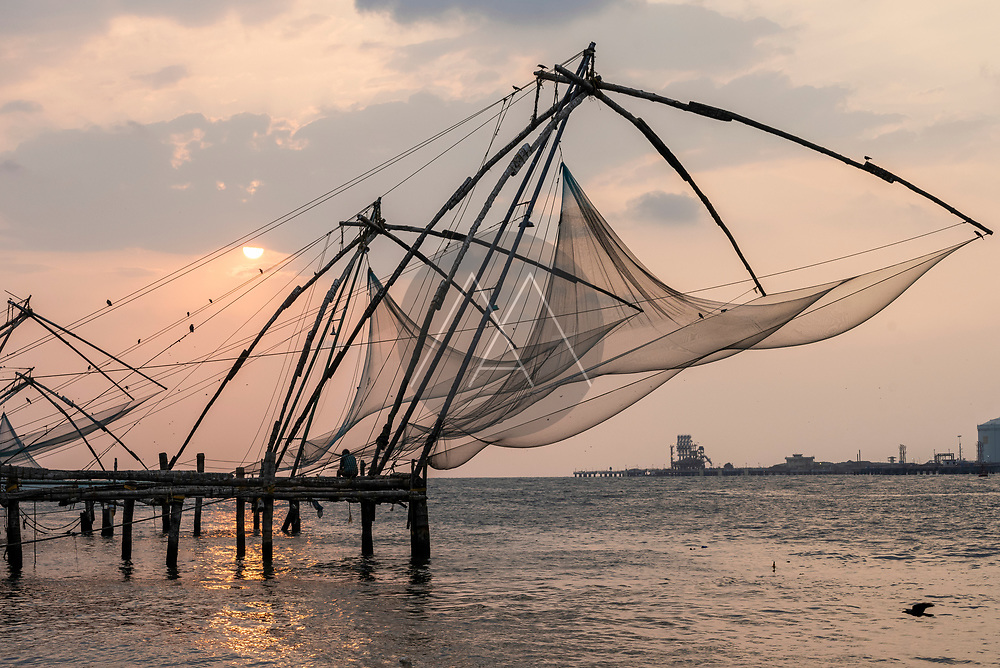 View of Kochi old town along the river near the Chinese fishing nest, Kerala, India.