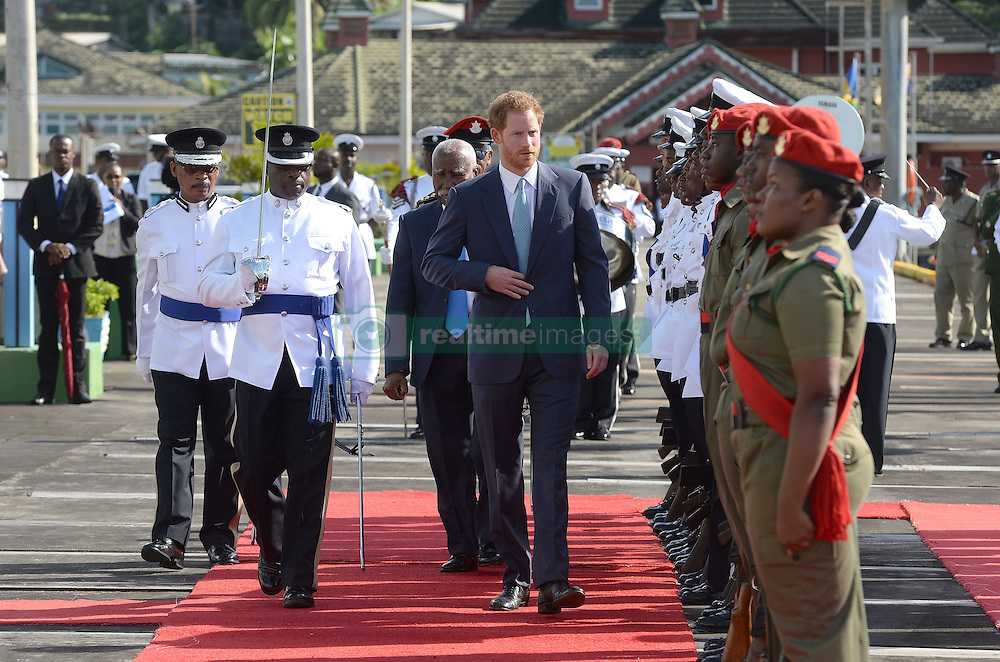 Prince Harry inspects the Guard of Honour after arriving at the Kingstown Cruise Terminal Pier on the island of Saint Vincent and the Grenadines, during the second leg of his Caribbean tour.