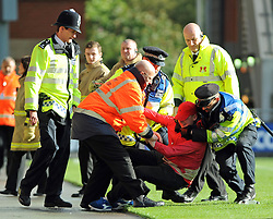Swindon fan runs onto pitch and arrested by police - photo mandatory by-line David Purday JMP- Tel: Mobile 07966 386802 - 04/10/14 - Leyton Orient  v Swindon Town - SPORT - FOOTBALL - Sky Bet Leauge 1  - London -  Matchroom Stadium