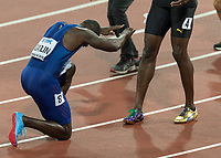 Athletics - 2017 IAAF London World Athletics Championships - Day Two, Evening Session<br /> <br /> Mens 100m Final <br /> <br /> Justin Gatlin (United States) winner of the 100m title bows before the feet of Usain Bolt (Jamaica) at the London Stadium<br /> <br /> COLORSPORT/DANIEL BEARHAM