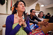 19 DECEMBER 2010 - PHOENIX, AZ: DULCE JUAREZ, a student at Arizona State University, prays at a prayer service for the DREAM Act in Phoenix. About 100 supporters of the DREAM Act gathered at First Congregational Church of Christ in Phoenix Sunday night, December 19, for a prayer vigil in support of the DREAM Act, which was defeated in the US Senate Saturday, Dec. 18. The DREAM Act, was supported by the Obama administration, and was an important part of the administration's immigration reform platform. The defeat of the DREAM Act, which would have established a path to citizenship for undocumented immigrants who were brought to the US by their parents when they were children, set back the President's immigration reform efforts.    PHOTO BY JACK KURTZ