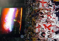 Photo: Richard Lane.<br />Australia v England. Rugby World Cup Final, at the Telstra Stadium, Sydney. RWC 2003. 22/11/2003. <br />England fans celebrate victory.