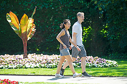 © Licensed to London News Pictures 16/06/2021. Greenwich, UK. A man and a woman look happy as they walk in Greenwich park gardens in London. Today could be the hottest day of the year so far with temperatures predicted to hit 30C. Photo credit:Grant Falvey/LNP
