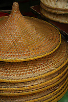 Cantonese Conical Hats - The conical Asian hat, sedge hat, rice hat, paddy hat is a simple conical hat originating in East, South Asia and Southeast Asia, particularly China, Cambodia, Indonesia, Japan, Korea, Philippines, India and Vietnam. It is kept on the head by a cloth chin strap; The hat is useful as protection from the sun and rain.